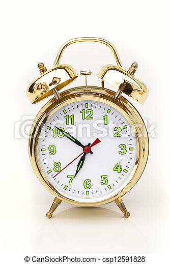 Reloj de alarma sobre fondo blanco - csp12591828