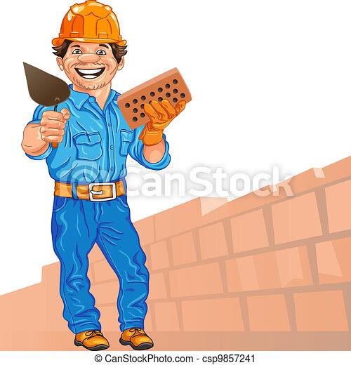 Alegre albañil en el casco naranja con ladrillo y una paleta en mano, contra un fondo de pared de ladrillo - csp9857241
