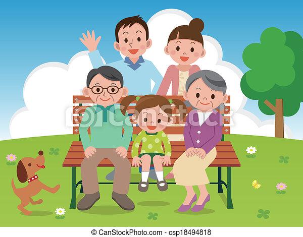 Familia feliz sentada en un parque Benc - csp18494818