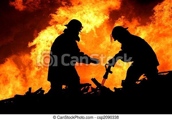 Valientes bomberos en silueta - csp2090338