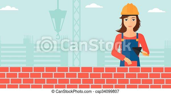 Bricklayer con espátula y ladrillo. - csp34099807
