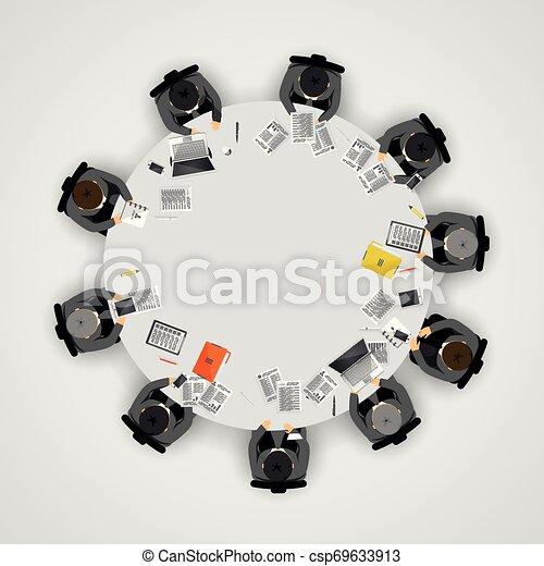 Gente de negocios en una mesa redonda. Un concepto de trabajo en equipo - csp69633913