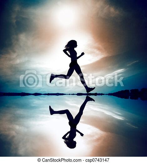 Runner silhouetted reflec - csp0743147