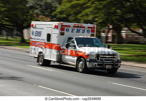 Una ambulancia de servicios médicos de urgencia, con movimiento borroso - csp3549689