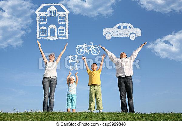 Familia de cuatro en la hierba con manos arriba y sueños, collage - csp3929848