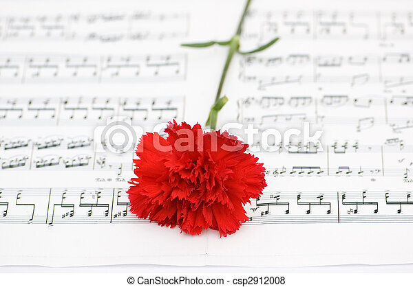 Flor de claveles rojos en notas musicales - csp2912008