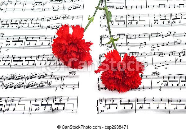 Flor de clavel rojo en notas musicales - csp2938471