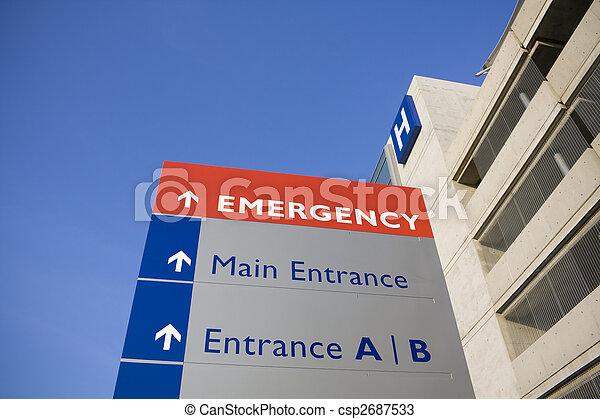 Hospital moderno y señal de emergencia - csp2687533
