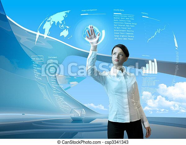 Morena atractiva con interfaz en el interior futurista - csp3341343