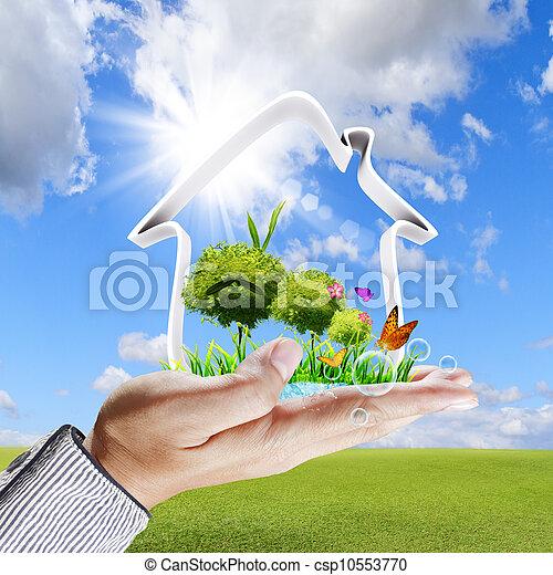 La mano humana muestra un concepto de casa verde - csp10553770