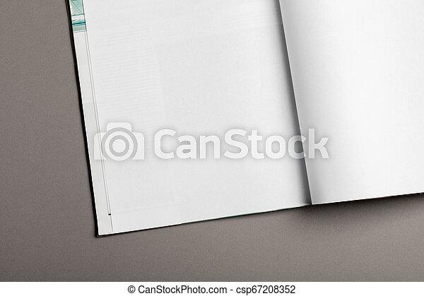 La revista Blank Brochure aislada en gris para reemplazar tu diseño - csp67208352