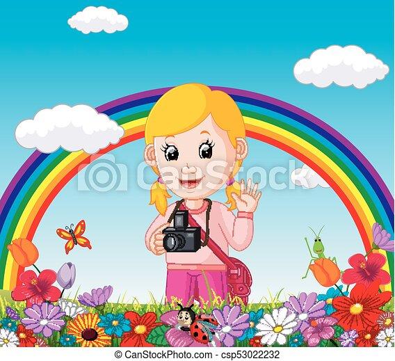 Linda chica en un jardín de flores con arco iris - csp53022232