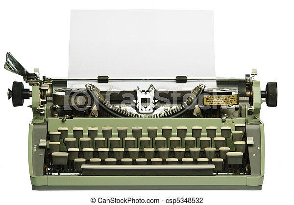 Una máquina de escribir con papel en blanco - csp5348532