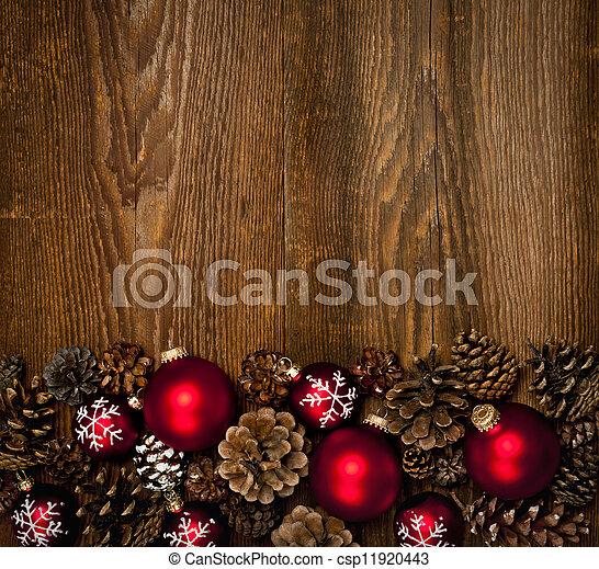 Un fondo de madera con adornos navideños - csp11920443