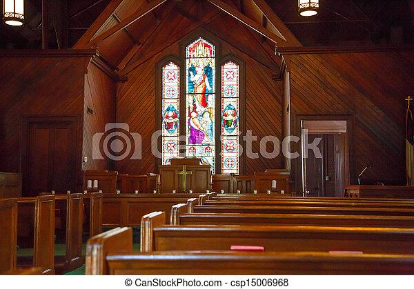 Peces de madera y cristales manchados en la pequeña iglesia - csp15006968