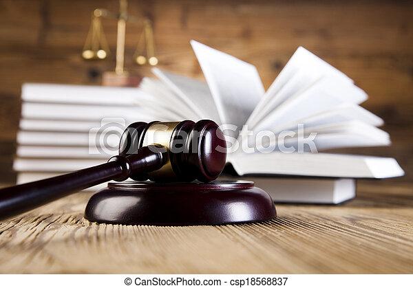 Wooden diol y libros de leyes - csp18568837