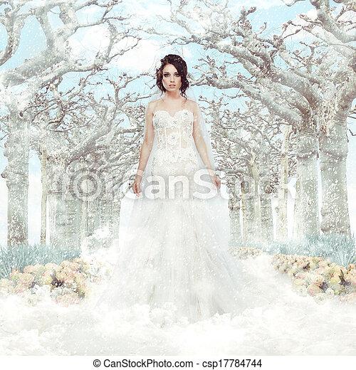 Fantasía. Matrimonio. Novia con vestido blanco sobre árboles de invierno congelados y copos de nieve - csp17784744