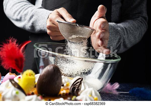 Preparando una Mona de Pascua, un pastel de Pascua español - csp68382369