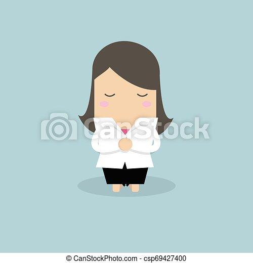 Mujer de negocios rezando de rodillas. - csp69427400