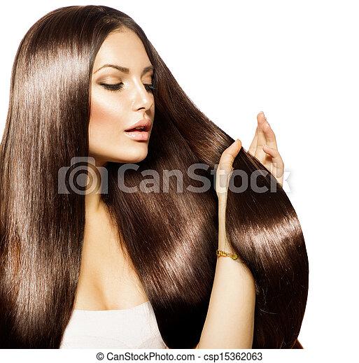 Mujer hermosa tocando su largo y saludable cabello marrón - csp15362063