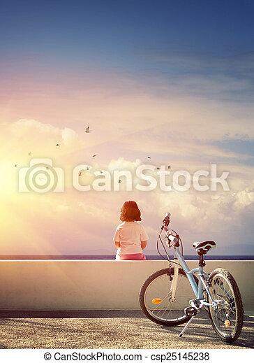 Chica y bicicleta - csp25145238