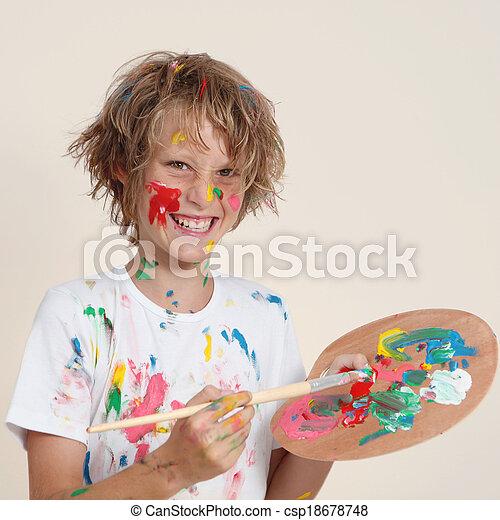 Niño desordenado con pallete de pintura - csp18678748