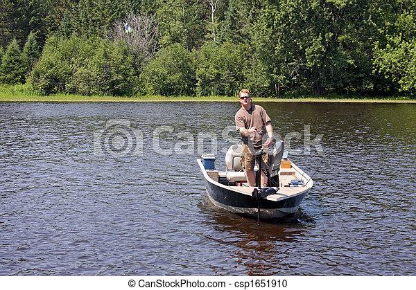 Pescador en un barco - csp1651910