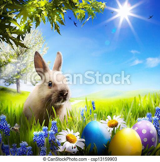 Art Little Easter Bunny y huevos de Pascua sobre hierba verde - csp13159903