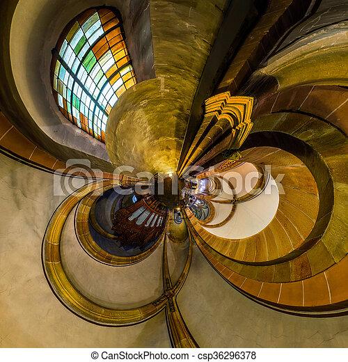 La vista del caleidoscopio del interior de la iglesia gótica, pequeño efecto planetario de tiro panorámico. Andlau, Francia. - csp36296378