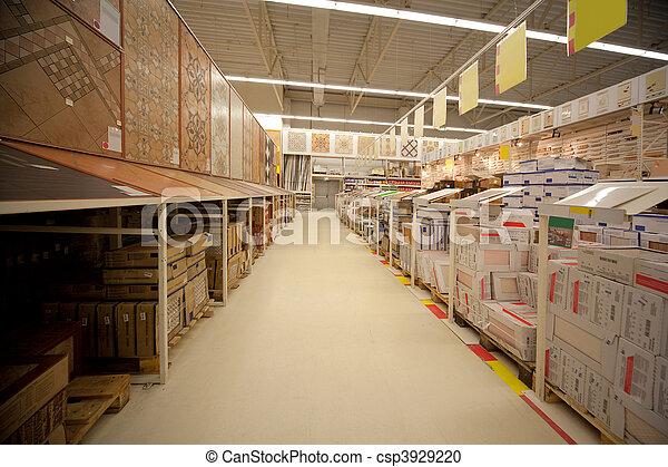 Racks con azulejos de cerámica en el depósito de materiales de construcción - csp3929220