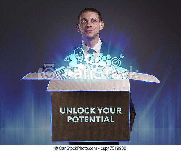 """Negocios, tecnología, Internet y el concepto de red. Un joven hombre de negocios muestra la palabra """"desbloquea tu potencial - csp47519932"""