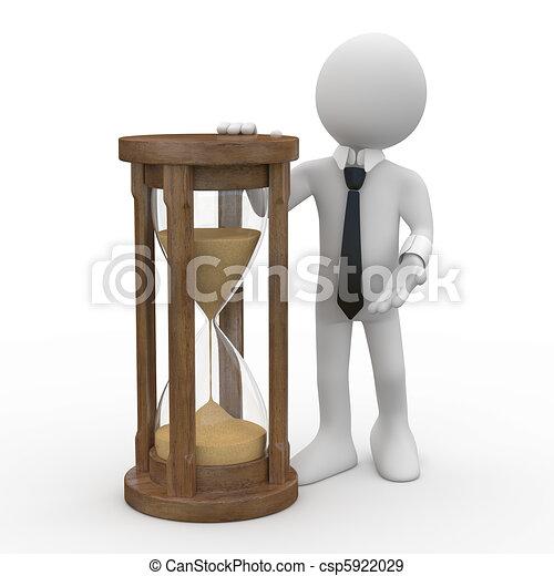 Un hombre con un reloj de arena - csp5922029