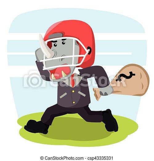 Rinoceronte de negocios con casco de fútbol que lleva choza de dinero - csp43335331