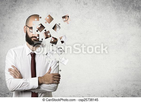 Un rompecabezas de hombre de negocios - csp25738145