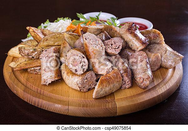 Salchichas con salsa - csp49075854