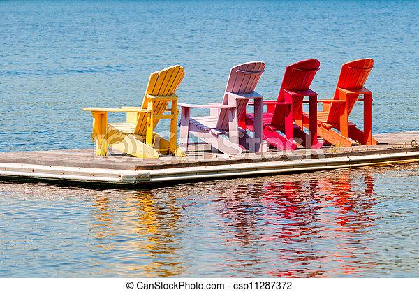 sillas coloridas en un muelle - csp11287372