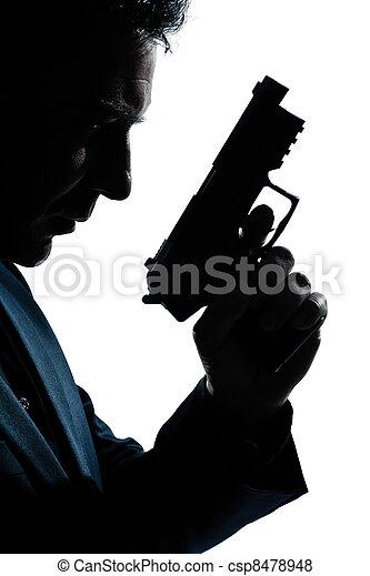 Silueta, retrato de hombre con pistola - csp8478948
