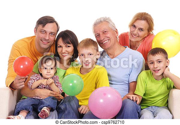 Feliz familia en el sofá - csp9762710