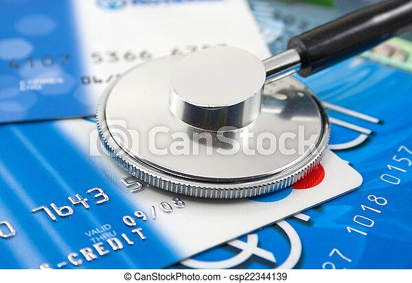 Un estetoscopio por un pago de tarjetas de crédito - csp22344139
