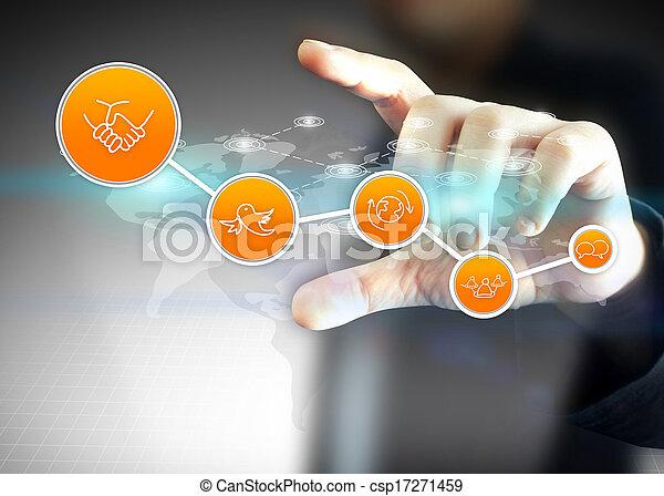 La mano sosteniendo redes sociales, concepto de red social - csp17271459