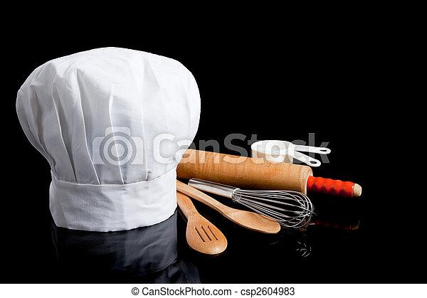 Toque con utensilios de cocina - csp2604983