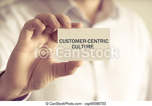 Un empresario con una tarjeta de crédito de clientes - csp45588703