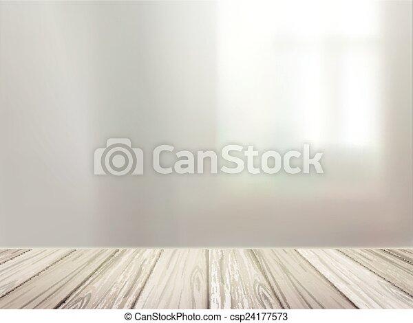 Un escritorio de madera sobre una escena interior borrosa - csp24177573