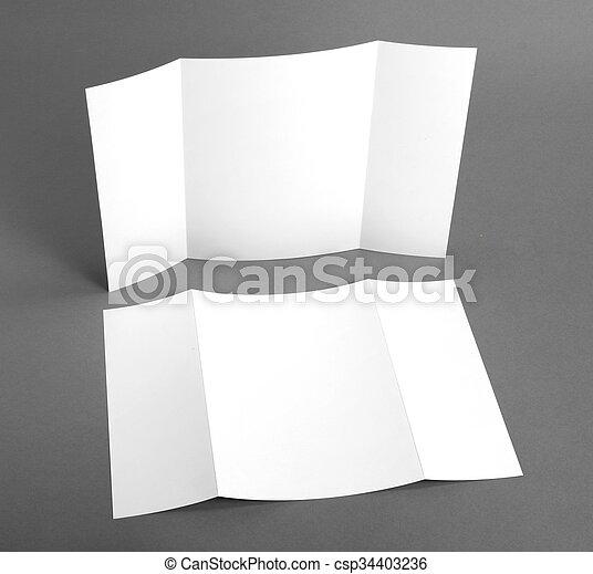 Un folleto en blanco sobre grises para reemplazar tu diseño. - csp34403236