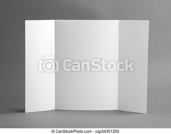 Un folleto en blanco sobre grises para reemplazar tu diseño. - csp34351255