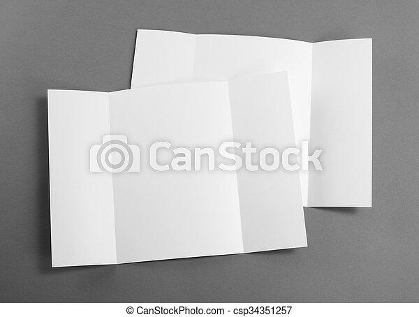 Un folleto en blanco sobre grises para reemplazar tu diseño. - csp34351257