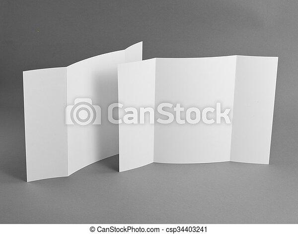 Un folleto en blanco sobre grises para reemplazar tu diseño. - csp34403241