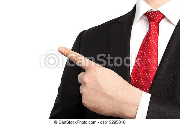 Un hombre de negocios con traje y corbata roja señala un objeto - csp13295816
