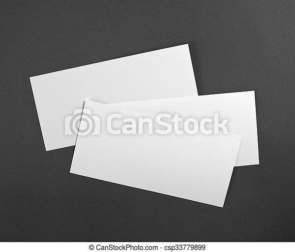 Un póster en blanco sobre un fondo gris para reemplazar tu diseño. - csp33779899