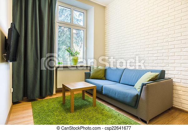 Un sofá cómodo en un piso pequeño - csp22641677
